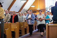 "The last service begins at St. Frances Xavier Cabrini Church in Scituate, Mass., on Sun., May 29, 2016. Members of the congregation have been holding a vigil for more than 11 years after the Archdiocese of Boston ordered the parish closed in 2004. For 4234 days, at least one member of Friends of St. Frances X. Cabrini has been at the church at all times, preventing the closure of the church. May 29, 2016, was the last service held at the church after members finally agreed to leave the building after the US Supreme Court decided not to hear their appeal to earlier an Massachusetts court ruling stating that they must leave. The last service was called a ""transitional mass"" and was the first sanctioned mass performed at the church since the vigil began."