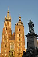 Poland, Krakow, St. Mary's Church, and  Statue of Adam Mickiewicz, Rynek Glowny, Grand Square