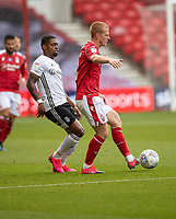 7th July 2020; City Ground, Nottinghamshire, Midlands, England; English Championship Football, Nottingham Forest versus Fulham; Joe Worrall of Notts Forest under pressure from Ivan Cavaleiro of Fulham