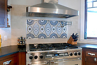 This custom kitchen features a handmade Amulet mosaic backsplash shown in hand-chopped and tumbled Blue Macaubas, Montevideo, Thassos, Chartreuse, Celeste, Travertine White from New Ravenna.<br />
