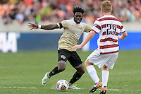 Houston, TX - Friday December 11, 2016: Ema Twumasi (22) of the Wake Forest Demon Deacons attempts to dribble the ball around Derek Waldeck (29) of the Stanford Cardinal at the NCAA Men's Soccer Finals at BBVA Compass Stadium in Houston Texas.