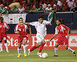 21 June 2007:  Mexico's Carlos Salcido (3) dribbles past Guadeloupe's Michael Tacalfred (20) and Stephane Auvray (8). The National Team of Mexico defeated Guadeloupe 1-0  in a CONCACAF Gold Cup Semifinal match at Soldier Field in Chicago, Illinois.