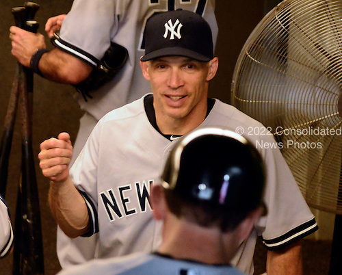 New York Yankees manager Joe Girardi (28) celebrates his team's 7 -2 victory over the Washington Nationals at Nationals Park in Washington, D.C. on Friday, June 15, 2012.  .Credit: Ron Sachs / CNP.(RESTRICTION: NO New York or New Jersey Newspapers or newspapers within a 75 mile radius of New York City)