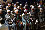 Egyptian clerics from Al-Azhar institution offer condolences to Egyptian Coptics after the murdered of Egyptian Coptic Christians murdered by Islamic State (IS) group militants in Libya, in Minya Church, south of Cairo  on February 17, 2015. Egypt called for a UN-backed international intervention in Libya after launching air strikes on Islamic State group targets in the country following the jihadists' beheadings of the Egyptian Coptic Christians on a Libyan beach. Photo by Amr Sayed