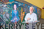 Local artist Jim Dunne pictured with a mural done by community volunteers as part of the Tidy Towns, the mural shows aspects of life in Athea Village, pictured here last Friday morning.