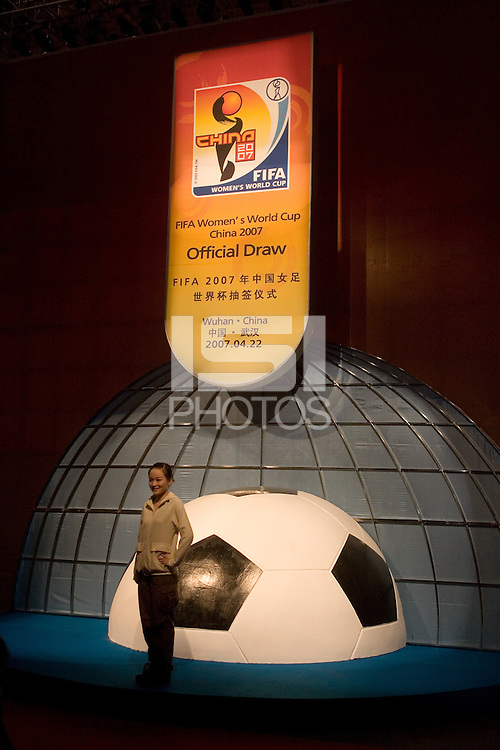 A spectator poses at the entrance to the 2007 FIFA Women's World Cup Draw on April 22, 2007 in Wuhan, China