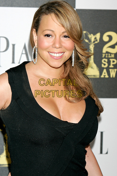 MARIAH CAREY.25th Annual Film Independent Spirit Awards - Arrivals held at the Nokia Event Deck at L.A. Live, Los Angeles, California, USA. .March 5th, 2010 .half length black dress silver hoop earrings smiling cleavage.CAP/JE.©James Eden/Capital Pictures