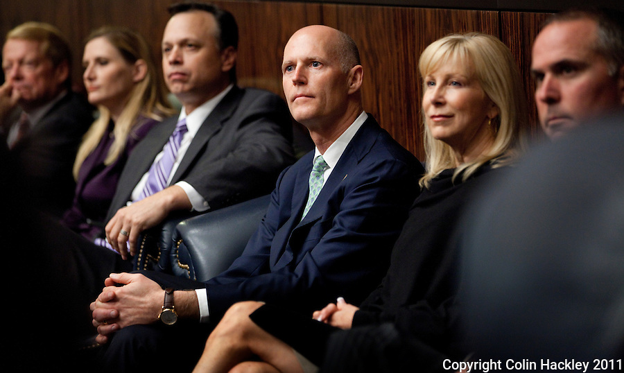 TALLAHASSEE, FLA. 3/8/11-OPENINGDAY030811 CH-Gov. Rick Scott, center, and his wife Ann, right, listens to Senate President Mike Haridopolos, R-Melbourne, address his chamber during the opening day of the 2011 legislative session Tuesday at the Capitol in Tallahassee. Seated to Scott's left is former Senate President Tom Lee..COLIN HACKLEY PHOTO