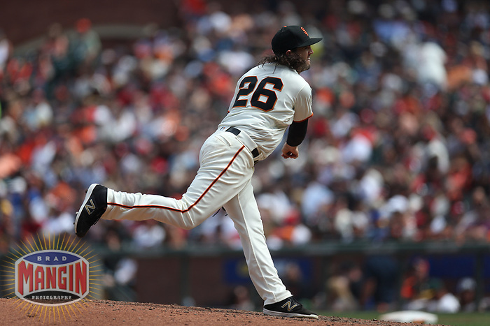 SAN FRANCISCO, CA - JULY 7:  Cory Gearrin #26 of the San Francisco Giants pitches against the St. Louis Cardinals during the game at AT&T Park on Saturday, July 7, 2018 in San Francisco, California. (Photo by Brad Mangin)