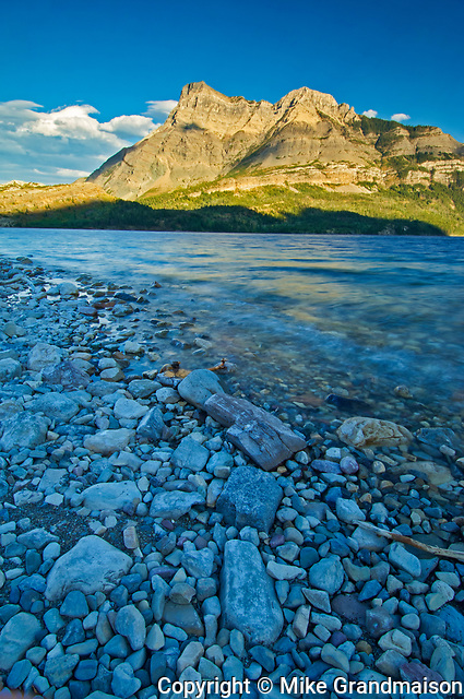 Evening light at Waterton Lakes and Vimy Peak (Ridge). Vimy Peak is the front range mountain standing east of the townsite in Waterton National Park. Vimy Ridge stretches for three km to the southeast of the peak. It was originally called Sheep Mountain and Goat Mountain. , Waterton Lakes National Park, Alberta, Canada
