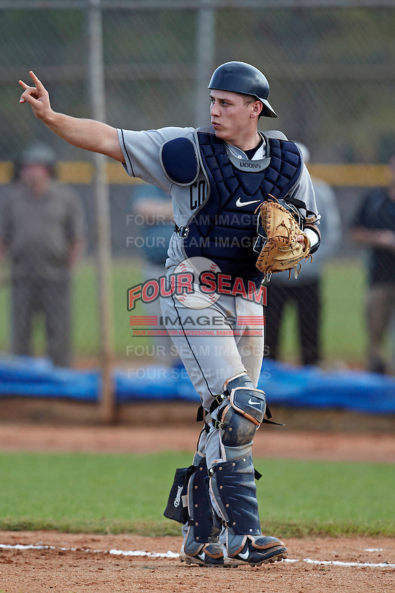 Connecticut Huskies catcher Joe Pavone #5 during a game against the Purdue Boilermakers at the Big Ten/Big East Challenge at Walter Fuller Complex on February 18, 2012 in St. Petersburg, Florida.  (Mike Janes/Four Seam Images)