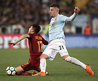 Calcio, Serie A: S.S. Lazio - A.S. Roma, stadio Olimpico, Roma, 15 aprile 2018. <br /> Roma's Cengiz Under (l) in action with Lazio's Sergej Milinkovic (r) during the Italian Serie A football match between S.S. Lazio and A.S. Roma at Rome's Olympic stadium, Rome on April 15, 2018.<br /> UPDATE IMAGES PRESS/Isabella Bonotto