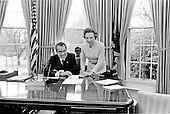 United States President Richard M. Nixon and his secretary, Rose Mary Woods, take a break from their work to pose for a photo in the Oval Office of the White House in Washington, D.C. on February 2, 1973.<br /> Credit: White House via CNP