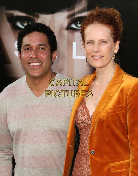 "OSCAR NUEZ & CARLA NUNEZ.""Salt"" Los Angeles Premiere held at Grauman's Chinese Theatre, Hollywood, California, USA, 19th July 2010..half length grey gray pink striped jumper v-neck orange velvet jacket red lace couple  married husband wife .CAP/ADM/KB.©Kevan Brooks/AdMedia/Capital Pictures."