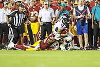 Landover, MD - August 24, 2018: Washington Redskins linebacker Vontae Diggs (48) tackles Denver Broncos quarterback Paxton Lynch (12) during the preseason game between Denver Broncos and Washington Redskins at FedEx Field in Landover, MD.   (Photo by Elliott Brown/Media Images International)