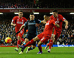 Sergio Aguero of Manchester City surrounded by three Liverpool players - English Premier League - Liverpool vs Manchester City - Anfield Stadium - Liverpool - England - 3rd March 2016 - Picture Simon Bellis/Sportimage