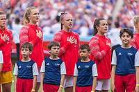 PARIS,  - JUNE 28: Sam Mewis #3, Becky Sauerbrunn #4 and Kelley O'Hara #5 stand for the national anthem during a game between France and USWNT at Parc des Princes on June 28, 2019 in Paris, France.