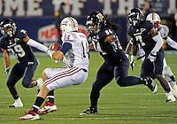 Florida International University football player defensive lineman James Jones (94) plays against the Florida Atlantic University on November 12, 2011 at Miami, Florida. FIU won the game 41-7. .
