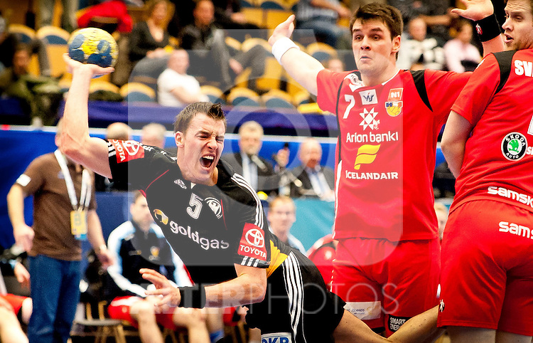 22.01.2011, Kinnarps Arena, Jönköping, SWE, IHF Handball Weltmeisterschaft 2011, Herren, Deutschland (GER) vs Island (ISL) im Bild, // Carsten Lichtlein (TBV Lemgo) 7 ATLASON Arnór// during the IHF 2011 World Men's Handball Championship match Germany (GER) vs Iceland (ISL)  at Kinnarps Arena in Jonkoping,   Foto © nph / Bildbyrån   - 56408