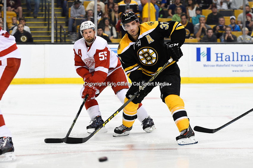 Monday, September 28, 2015, Boston, MA -  Boston Bruins center Patrice Bergeron (37) and Detroit Red Wings defenseman Niklas Kronwall (55) track the puck during the NHL game between the Detroit Red Wings and the Boston Bruins held at TD Garden, in Boston, Massachusetts. Detroit defeats Boston 3-1 in regulation time. Eric Canha/CSM