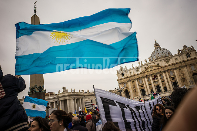 People with a flag from Argentina  on S.Peter Square in the Vatican attends Pope Francis  his first Angelus on Sunday , March 17 2013