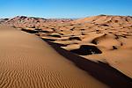 Sahara desert sand dunes with clear blue sky, Merzouga, Morocco.