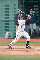 Miguel Ceballos (13) of the Virginia Tech Hokies follows through on his swing against the Toledo Rockets at The Ripken Experience on February 28, 2015 in Myrtle Beach, South Carolina.  The Hokies defeated the Rockets 1-0 in 10 innings.  (Brian Westerholt/Four Seam Images)