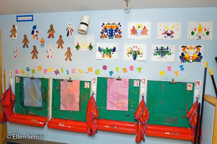 Washington, DC. Hoya Kids Learning Center at Georgetown University (private day care center for toddlers and preschoolers). ID: AI-gPhk. Paint easels and children's artwork in art area of pre-school classroom. © Ellen B. Senisi