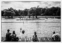 Henley. Berks, United Kingdom. 17th June 2017, Spectators, watch and wave, sitting  on the slipway of, &quot;Upper Thames RC.,&quot;  watch as the Umpires Launch, &quot;Consulta&quot;, passes  2017 Henley' Women's Regatta. Rowing on, Henley Reach. River Thames. <br /> <br /> <br /> Saturday  17/06/2017<br /> <br /> <br /> &quot;Film Noir Style Photography&quot;, &copy; Peter SPURRIER,