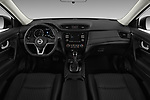Stock photo of straight dashboard view of 2017 Nissan Rogue S 5 Door SUV Dashboard