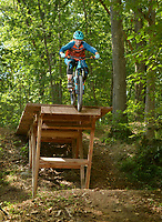 NWA Democrat-Gazette/BEN GOFF @NWABENGOFF<br /> Jordan Sauls of Centerton launches off a drop on the Drop the Hammer trail Thursday, July 20, 2017, at Coler Preserve in Bentonville.