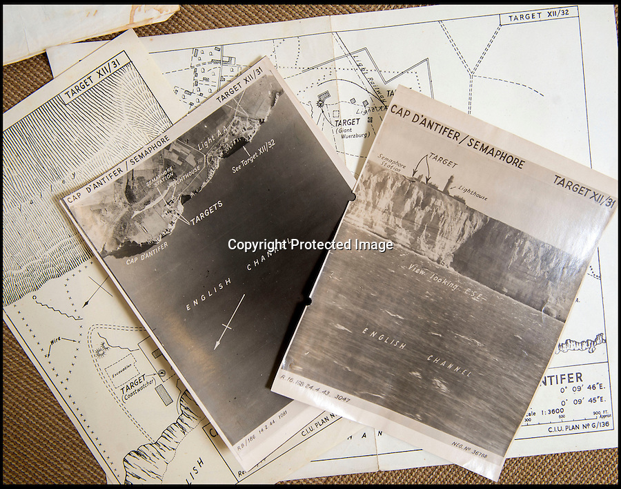 BNPS.co.uk(01202 558833)<br /> Pic: C&TAuctions/BNPS<br /> <br /> Attack plans with targets marked and photo's for the lighthouse at Cap D'antifer<br /> <br /> Found in a french flea market - a Top Secret 'how to' guide to D-Day.<br /> <br /> Fascinating top secret documents and photos of the extensive planning that went into the Normandy invasion have emerged after 72 years.<br /> <br /> Incredibly detailed plans of Nazi defences, high resolution photographs, weekly intel reports and even analysis of the German weapons they were likely to face are included in the sale.<br /> <br /> One photo taken at zero feet shows German troops scattering across a beach as a low-level RAF aircraft sweeps by to capture the plethora of anti-landing obstacles.<br /> <br /> Other images show the famous coastline with key cliff-top targets that had to be destroyed either before or on D-Day itself.<br /> <br /> The archive is being sold by C&T Auctions of Kent.