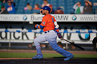 New York Mets Robinson Cano (4), on rehab assignment with the Syracuse Mets, hits an RBI single during a game against the Charlotte Knights on June 11, 2019 at NBT Bank Stadium in Syracuse, New York.  (Mike Janes/Four Seam Images)