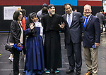 Josephine Esteban, left, and her husband, A. Gabriel Esteban, Ph.D., president of DePaul, second from right, pose with Eugene Zdziarski, vice president of student affairs, far right, along with Cree Noble and Mateo Leuto as the pair portray Louise de Marillac and Vincent de Paul during New Student Service Day at McGrath-Phillips Arena Tuesday, Sept. 5, 2017. Students fanned out across the city to volunteer at dozens of community organizations following the early morning rally on the Lincoln Park Campus. (DePaul University/Jamie Moncrief)
