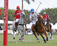 WELLINGTON, FL - MARCH 26:  Patron Bob Jornayvaz of Valiente takes an angled shot on goal as Coca Cola's patron Gillian Johnston (red jersey) looks on as Valiente defeats Coca Cola 9-6 in the final of the 26 goal USPA Gold Cup, at the International Polo Club, Palm Beach on March 26, 2017 in Wellington, Florida. (Photo by Liz Lamont/Eclipse Sportswire/Getty Images)