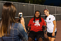 Eric LeGrand poses for a photo with Portland Thorns forward Alex Morgan (13) after the match. Sky Blue FC and the Portland Thorns played to a 0-0 tie during a National Women's Soccer League (NWSL) match at Yurcak Field in Piscataway, NJ, on June 22, 2013.