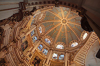 Inside the dome of the capilla mayor of Granada Cathedral, or the Cathedral of the Incarnation, built 16th and 17th centuries in Renaissance style with Baroque elements, Granada, Andalusia, Southern Spain. The dome is painted with a starry sky and there are 2 levels of 16th century stained glass windows above a series of paintings by Alonso Cano. Granada was listed as a UNESCO World Heritage Site in 1984. Picture by Manuel Cohen