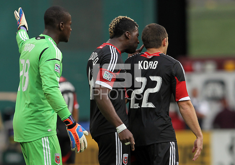 WASHINGTON, D.C. - AUGUST 19, 2012:  Brandon McDonald (4) of DC United argues with Chris Kolb (22) at the end of an MLS match against the Philadelphia Union at RFK Stadium, in Washington DC, on August 19. The game ended in a 1-1 tie.