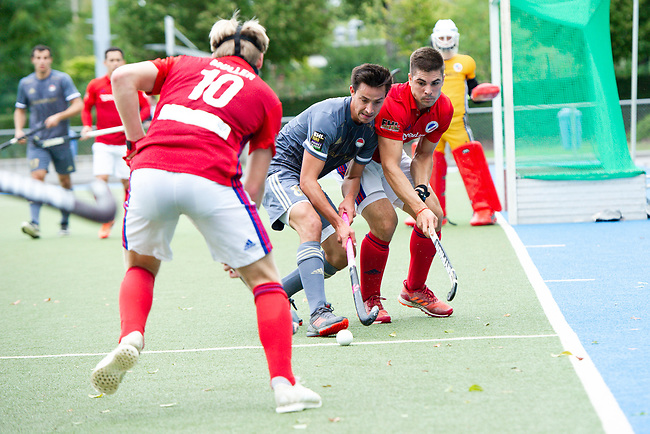 Mannheim, Germany, September 29: During the 1. Bundesliga men fieldhockey match between Mannheimer HC (red) and Rot-Weiss Koeln (grey) on September 29, 2019 at Am Neckarkanal in Mannheim, Germany. Final score 3-3 (HT 3-1). (worldsportpics Copyright Dirk Markgraf) *** Florian Adrians #8 of Rot-Weiss Koeln, Gonzalo Peillat #2 of Mannheimer HC