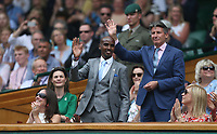 Long distance runner Mohamed Farah and Lord Sebastian Coe are introduced to the Centre Court crowd<br /> <br /> Photographer Rob Newell/CameraSport<br /> <br /> Wimbledon Lawn Tennis Championships - Day 6 - Saturday 6th July 2019 -  All England Lawn Tennis and Croquet Club - Wimbledon - London - England<br /> <br /> World Copyright © 2019 CameraSport. All rights reserved. 43 Linden Ave. Countesthorpe. Leicester. England. LE8 5PG - Tel: +44 (0) 116 277 4147 - admin@camerasport.com - www.camerasport.com