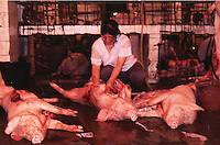 Workers slaughter pigs at an abattoir in Guangzhou, China.
