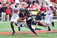 College Park, MD - NOV 26, 2016: Maryland Terrapins running back Ty Johnson (6) runs through the tackle of Rutgers Scarlet Knights defensive back Saquan Hampton (9) during the game between Maryland and Rutgers at Capital One Field at Maryland Stadium in College Park, MD. Maryland defeated Rutgers 31-13. (Photo by Phil Peters/Media Images International)