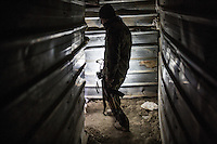 IRAK, Sheik Amir;; A peshmerga fighter is  inside a tunnel build by militant of Daesh in the town of Sheik Amir. This tunnel is 1km long, the 6th December 2016. <br /> <br /> IRAK, Sheik Amir; Un combattant peshmerga est dans un tunnel construit par des militants de Daesh dans la ville de Sheik Amir, ce tunnel fait 1km de long, le 6 d&eacute;cembre 2016.