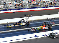 Feb 14, 2016; Pomona, CA, USA; NHRA top fuel driver Terry McMillen (near) defeats Tony Schumacher during the Winternationals at Auto Club Raceway at Pomona. Mandatory Credit: Mark J. Rebilas-USA TODAY Sports
