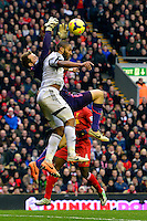 Sunday, 23 February 2014<br /> Pictured: Swansea City's Ashley Williams challenges Liverpool's Simon Mignolet for the ball<br /> Re: Barclay's Premier League, Liverpool FC v Swansea City FC v at Anfield Stadium, Liverpool Merseyside, UK.