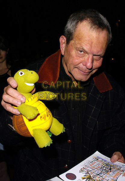 "TERRY GILIAM.Attends ""Monty Python's Spamalot"" VIP Gala Night, .Palace Theatre, London, England, October 17th 2006..half length toy tortoise animal autographed.Ref: CAN.www.capitalpictures.com.sales@capitalpictures.com.©Can Nguyen/Capital Pictures"