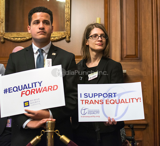 Washington DC, May 2, 2017,USA: Two supporters of the Equality Bill hold up signs at a Congressional press conference where Members of the House and Senate hold a press conference to re-introduce the Equality Act which guarantees protection for Lesbian, Gay,Bi-sexual and Transgender(LGBT) people throughout the United States.  Photo by Patsy Lynch/MediaPunch