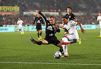 Pictured: Jefferson Montero of Swansea (R) against Tony Hibbert of Everton (L). Tuesday 23 September 2014<br /> Re: Capital One Cup, Swansea City FC v Everton at the Liberty Stadium, south Wales, UK