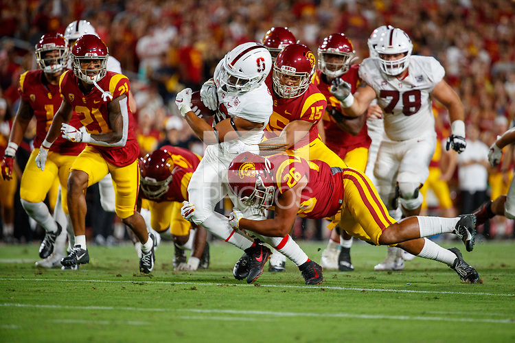 LOS ANGELES, CA - SEPTEMBER 7: USC Trojans Kana'i Mauga #26 tackles Stanford Cardinal running back Cameron Scarlett #22 during a game between USC and Stanford Football at Los Angeles Memorial Coliseum on September 7, 2019 in Los Angeles, California.