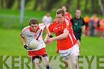 An Ghaeltacht's Pol O Bambaire and East Kerry's Kieran Murphy in action in the minor County championship final at Killorglin on Saturday.